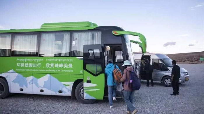 Travellers getting on the eco-bus