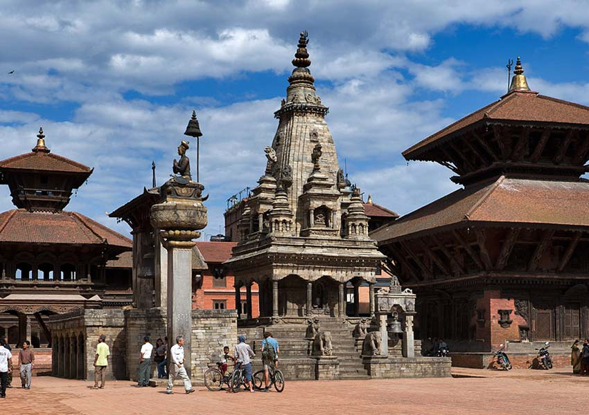 Bhaktapur Durbar Square is an assortment of pagoda and shikhara-style temples grouped around a fifty-five-window palace of brick and wood.
