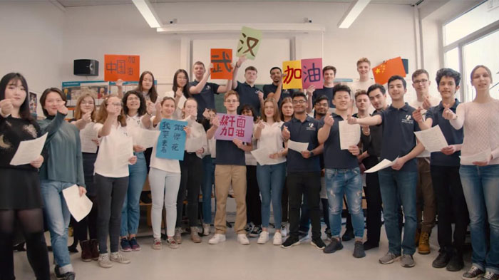 German students from Burg Gymnasium Essen sang songs to support Wuhan and China.