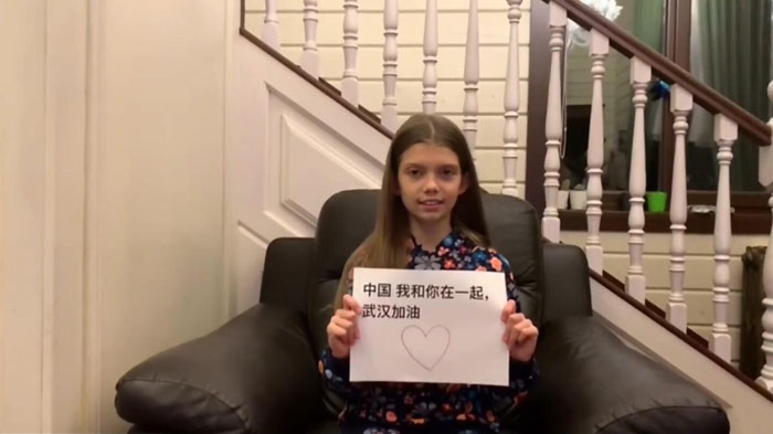 Lovely Russian kid Stayed together with Wuhan and China