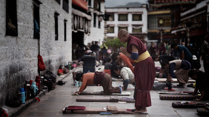 Tibetans prostrating in front of Jokhang Temple