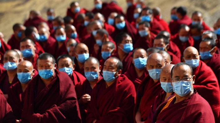 All the Tibetan monks were wearing masks