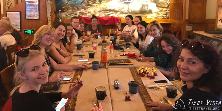 Enjoying a group dinner in a classic Tibetan restaurant in Lhasa