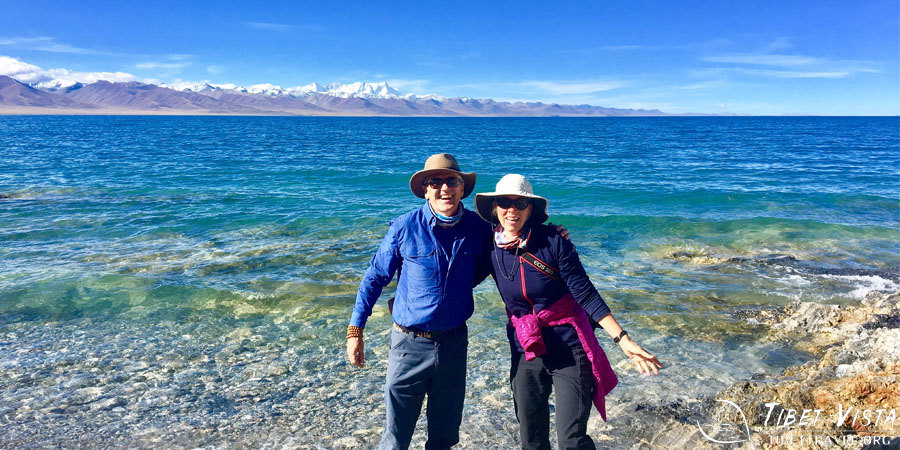 The multi-colored waves of Lake Namtso backed by the Nyenchen Tanglha Mountains