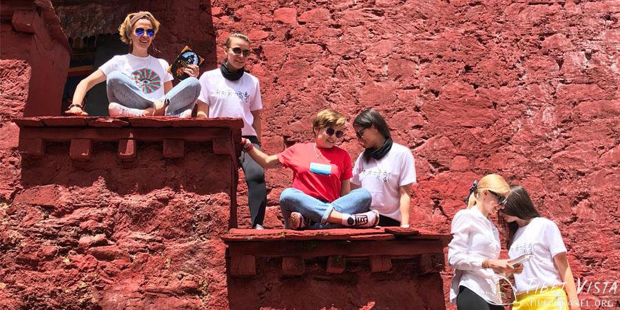 Taking a well-earned break from touring Ganden Monastery