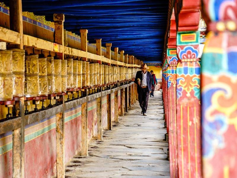 Local Tibetans turnning prayer wheels in Trandruk Monastery