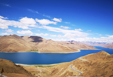 Enjoy the stunning view of turquoise Yamdrok Lake